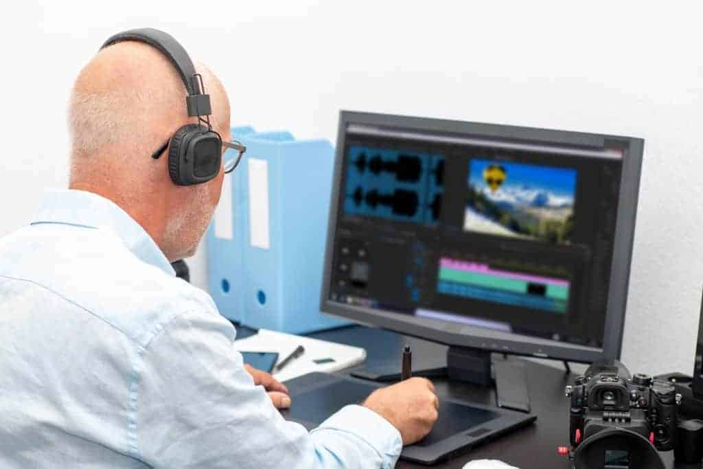 mature man designer using graphics tablet for video editing